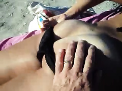 I just lay here rubbing my swollen rod with my hand on the beach