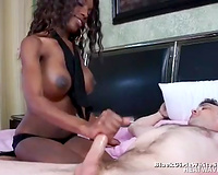 Black rapacious wench gives solid hand job to white stud