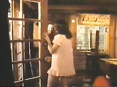 Retro clip with a sexy brunette hair giving hand to a fellow in the bedroom