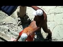 Horny bronze skin man on the beach pounding a woman