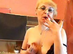 Mature blond plays with her mangos and pussy in webcam solo