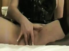 I put on my hawt latex corset and begin masturbating