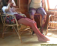 Seductive lesbos with pantyhosed legs are having enjoyment on camera