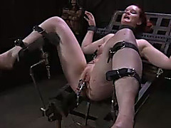 Lusty redhead bitch with a toy inside her cunt is bounded by her corporalist