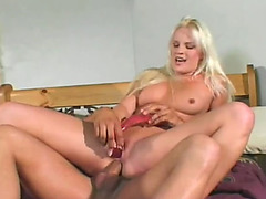 She pokes her twat with a sex-toy during the time that a smooth corpulent rod is in her chocolate hole