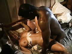 Caucasian blond honey with large titties is screwed hard in interracial fuck clip