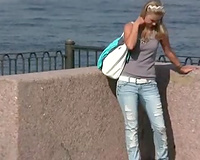 Adorable enchanting Russian blondie voided urine in her taut jeans