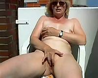 Slutwife masturbates on balcony