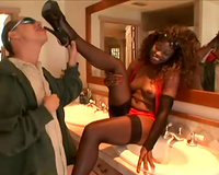 Black babe sits on his face in the washroom