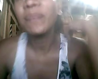 Ugly aged Filipina shows her cleavage and fingers her cunt