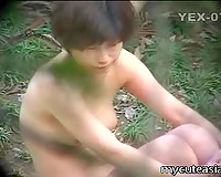 Hidden cam clip with amateur Asian angels bathing in a pool