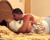Pretty exotic gal allows a man to eat her cunt in the bedroom