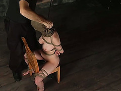 Gagged hussy receives her sore slit toyed and whipped in BDSM scene