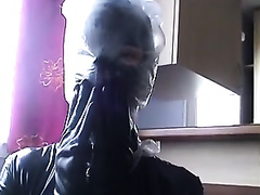 Nasty slut in latex outfit puts a plastic bag over her head