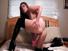 Horny milf in latex boots disrobes and masturbates with toys