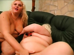 Two fat blondes have a fun toying every other's pussies indoors