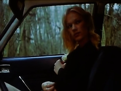 Cute blond fingers her love tunnel in a car and lets a fellow see her