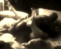 Black and white clip of black pumped up jerk permeating white whore on couch