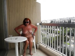 Chubby and old amateur wife on the resort hotel balcony