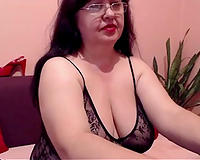 Dark-haired older hoe shows her large bra buddies for the web camera