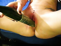 She puts a fuck-rubber on a lengthy cucumber and bonks herself