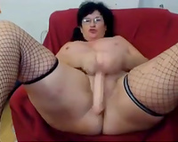 Mature wench with gigantic booty bonks her arsehole with her dildo