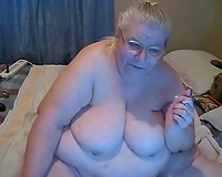 This old whore is a enormous smoker and she is proud of her overweight body