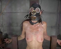 Wanton mama in gas mask sits in castigation chair and waits for torture