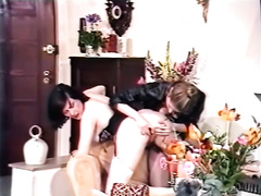 Curvy dominatrix-bitch in leather coat and fishnets gets team-fucked in three-some