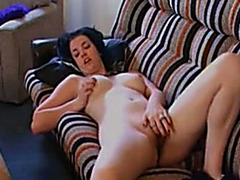 Sexy brunette hair wench rubs her moist cum-hole on the sofa