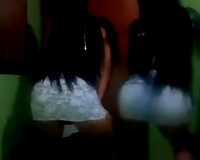 Hot cam clip with 2 brunettes shaking their booties