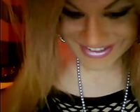 Sensual golden-haired tranny in front of a livecam in her fishnets