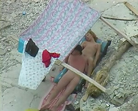 Amazing orall-service sex taped on the beach underneath the tent
