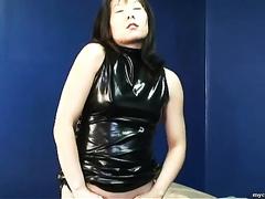 Amateur Asian prostitute in dark latex suit on webcam