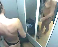 Well stacked dark brown tries on hot underware in changing room - spy web camera