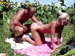 Teen girlfriend bows over for her boyfriend outdoors