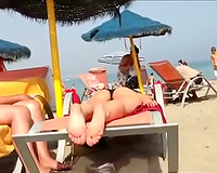 Hot and playful youthful sweethearts on the nudist beach filmed on my spy web camera