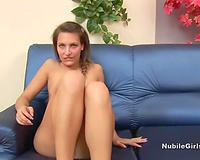 Solo act with a brown-haired beauty finger-fucking her crotch