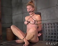 Blonde thrall with a ring gag in her throat is bounded and punished