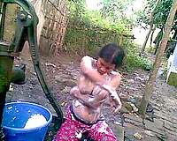 Incredibly excited slut with saggy scones enjoys outdoor bathing