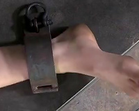 Horny skinny bitch lies crucified and ready for tortures
