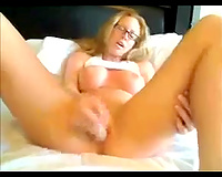 Blonde chick wearing glasses toys her cunt to orgasm