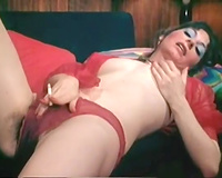 Desirable dark brown mama caresses her bushy cookie masturbating on a couch