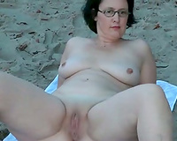 My ideal housewife taking sunbath on the nudist beach