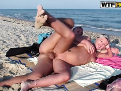 Horny non-professional couple have a fun having vehement doggy style sex on a beach