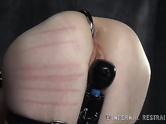 Bounded white lady with anal hook in her butt brutally spanked by her dominant
