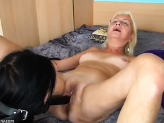 Mature golden-haired lesbo receives her twat toyed by a unrepining dark brown