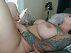 Perfect white tattooed milf on cam completely exposed