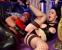 Gorgeous latex floozy in nylons bonks a perverted chap in mask