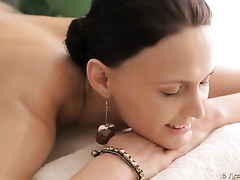 Pretty gal allows a masseur to oil and rub her body and ass